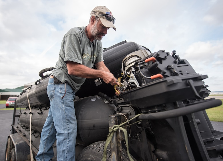 Gary King, a dive and maritime specialist assigned to the 123rd Special Tactics Squadron, works on the engine of a Zodiac boat at the Kentucky Air Guard Base in Louisville, Ky., Sept. 12, 2018.  The boats will be used by 123rd STS special operators who are deploying to the East Coast in response to Tropical Storm Florence.