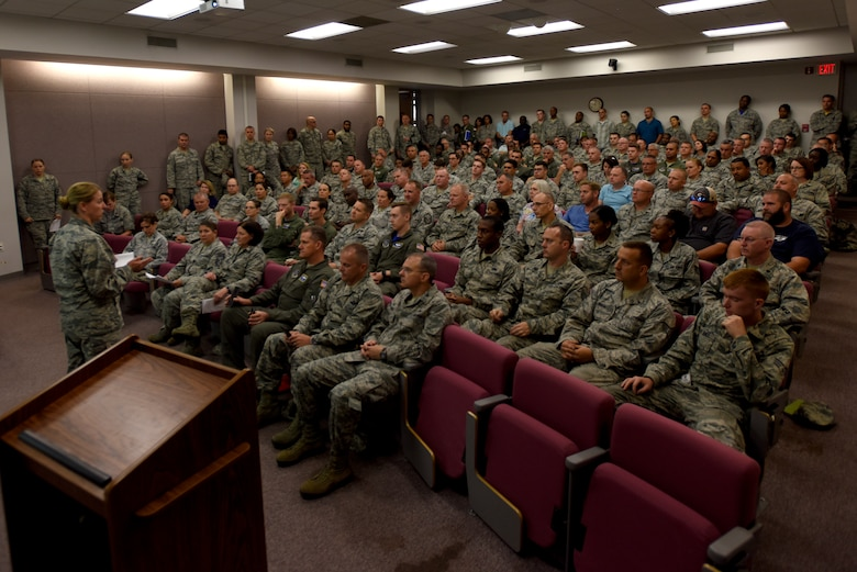 U.S. Air Force Col. Bryony Terrell, commander 145th Airlift Wing, delivers a brief during a meeting held at the North Carolina Air National Guard (NCANG) Base, Charlotte Douglas International Airport, Sept. 14, 2018. Airmen across the base prepare for power outages that may occur as a result of Hurricane Florence. Col. Terrell and other individuals from the NCANG brief on safety, weather updates, and forecasted strategies in the wake of Hurricane Florence.