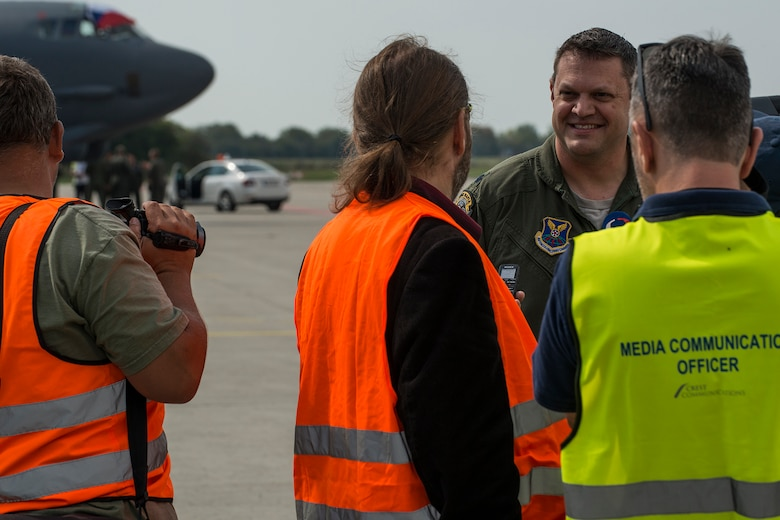 U.S. Air Force Lt. Col. William Fish, 11th Bomb Squadron commander, is interviewed by local media after arriving at the Ostrava Airport, Czech Republic, on Sept. 13, 2018, in support of the NATO Days air show. NATO Days consists of the presentation of heavy military hardware, police and rescue equipment, dynamic displays of Special Forces training, flying displays, and presentation of armaments, equipment and military gear. (U.S. Air Force photo by Master Sgt. Greg Steele)