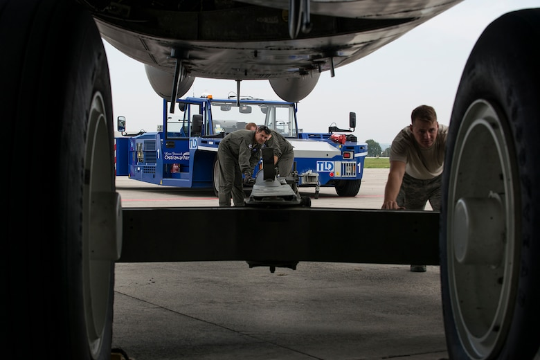Airmen assigned to the Air Force Reserve Command's 307th Bomb Wing, connect a tow bar to the front landing gear of a B-52H Stratofortress in preparation for towing on Sept. 13, 2018, Ostrava, Czech Republic. The Airmen and aircraft arrived in Ostrava in support of the NATO Days air show. (Master Sgt. Greg Steele)