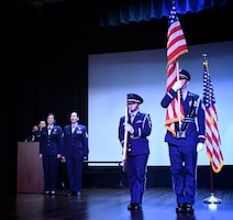 """Singing the national anthem, """"The Star Spangled Banner"""", 1st Lt. Rebecca Smith and Master Sgt. Karen Ridge help members of the 932nd Airlift Wing Honor Guard show respect for the American flag  at the start of the unit's Non-Commisioned and Senior Non-Commissioned Officer Induction Ceremony.  It was held as a special event during the 932nd AW's Unit Training Assembly, September 9, 2018, at Scott Air Force Base, Illinois.  Friends, family, and co-workers cheered as the new inductees walked up to collect their promotion certificates from the commander of the wing, Col. Raymond Smith, and the Command Chief, Chief Master Sgt. Barbara Gilmore.  The event recognized the leadership and skills of those members achieving higher ranks and leadership expectation status recently.  (U.S. Air Force photo by Lt. Col. Stan Paregien)"""