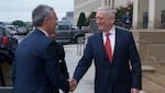 Defense Secretary Jim Mattis greets NATO Secretary General Jens Stoltenberg preceding a Pentagon meeting.