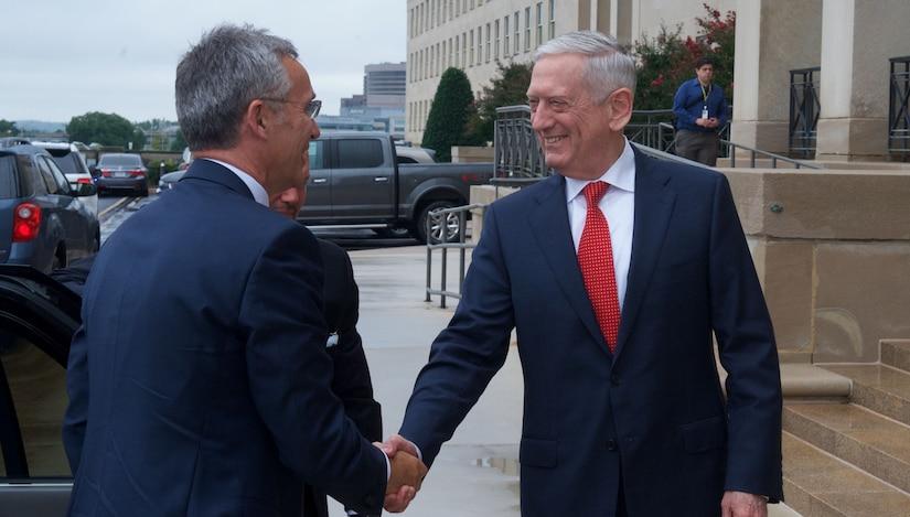Defense Secretary Jim Mattis greets NATO Secretary General Jens Stoltenberg preceding a Pentagon meeting.