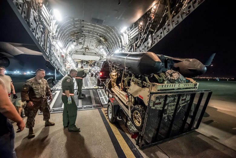 Airmen from the 123rd Airlift Wing load vehicles and cargo onto a C-17 Globemaster III aircraft at the Kentucky Air National Guard Base in Louisville, Ky., Sept. 15, 2018, in response to Tropical Storm Florence. The gear and 10 Airmen from the 123rd Special Tactics Squadron are being deployed to Naval Air Station Oceana in Virginia Beach, Va., to provide stand-alone communications, air traffic control, personnel recovery and paramedic capabilities in response to massive flooding.