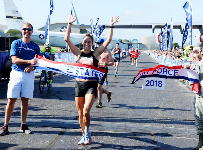 Sarah Bishop crosses the finish line of the Air Force Marathon full marathon at Wright-Patterson Air Force Base on Sept. 15, 2018.  Bishop, from Dayton, Ohio, won the women's division with a time of  XXXXXXXXX. (U.S. Air Force photo / Wesley Farnsworth)
