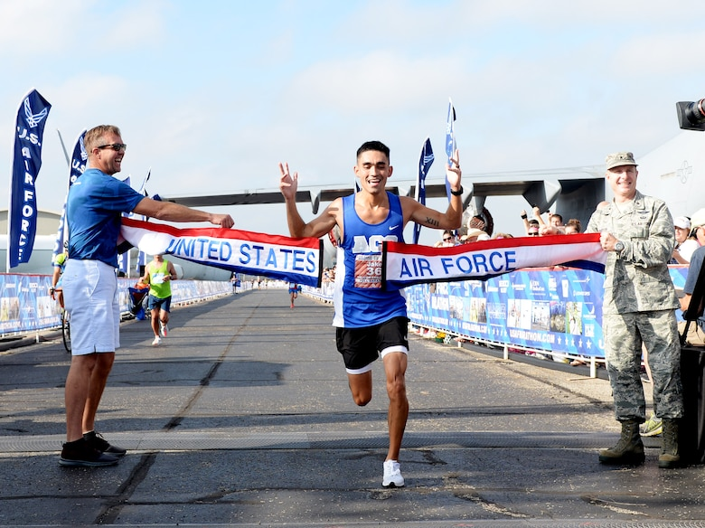 SSgt Jacob McCubbin crosses the finish line of the Air Force Marathon full marathon at Wright-Patterson Air Force Base on Sept. 15, 2018.  McCubbin, from San Antonio, Texas, won the men's division with a time of  2:35:57. (U.S. Air Force photo / Wesley Farnsworth)