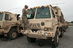 Soldiers assigned to the Virginia National Guard's 1173rd Transportation Company, 529th Combat Sustainment Support Battalion, 329th Regional Support Group assemble six Light Medium Tactical Vehicles with supplies including food, fuel, protectice equipment met and wet weather gear Sept. 13, 2018, at the State Military Reservation in Virginia Beach. The LMTVs deployed to fire stations in Chesapeake, Virginia, to assist with possible hurricane response operations as Hurricane Florence makes landfall.