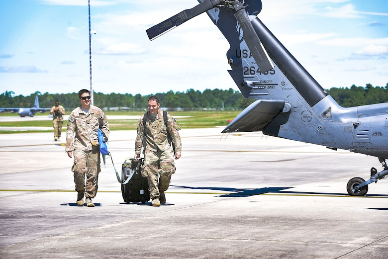 Airmen from the 41st Helicopter Maintenance Unit advance towards an HH-60G Pavehawk helicopter to perform maintenance, Sept. 15, 2018, at Moody Air Force Base, Ga. The 334th Air Expeditionary Group launched HC-130J Combat King IIs, HH-60G Pavehawks, aircrew and support personnel to pre-position at Joint Base Charleston, S.C., for potential Tropical Storm Florence response. Under the command of Col. John Creel, the 374th Rescue Group commander, the AEG integrated to make one expeditionary search and rescue unit comprised of rescue and support personnel from both the 23d Wing, 920th Rescue Wing at Patrick Air Force Base, Fla., and 51st Combat Communications Squadron at Robins Air Force Base, Ga. (U.S. Air Force photo by Senior Airman Greg Nash)