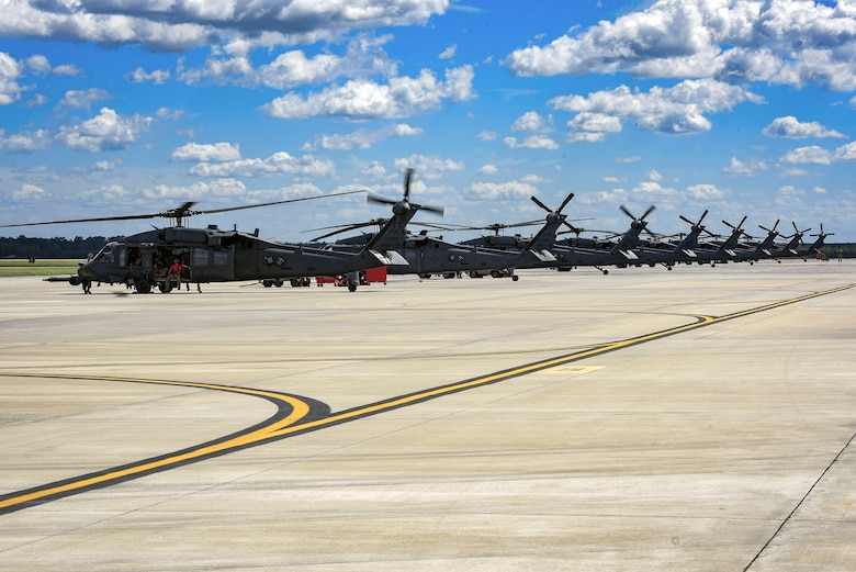 HH-60G Pavehawk helicopters position for departure in support Tropical Storm Florence relief operations, Sept. 15, 2018, at Moody Air Force Base, Ga. The 334th Air Expeditionary Group launched HC-130J Combat King IIs, HH-60G Pavehawks, aircrew and support personnel to pre-position at Joint Base Charleston, S.C., for potential Tropical Storm Florence response. Under the command of Col. John Creel, the 374th Rescue Group commander, the AEG integrated to make one expeditionary search and rescue unit comprised of rescue and support personnel from both the 23d Wing, 920th Rescue Wing at Patrick Air Force Base, Fla., and 51st Combat Communications Squadron at Robins Air Force Base, Ga. (U.S. Air Force photo by Senior Airman Greg Nash)