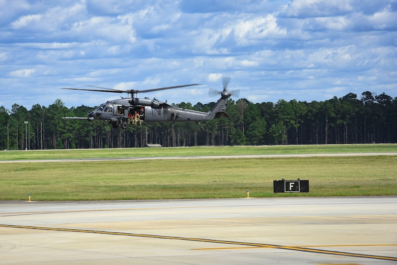 An HH-60G Pavehawk helicopter launches in support of Tropical Storm Florence relief operations, Sept. 15, 2018, at Moody Air Force Base, Ga. The 334th Air Expeditionary Group launched HC-130J Combat King IIs, HH-60G Pavehawks, aircrew and support personnel to pre-position at Joint Base Charleston, S.C., for potential Tropical Storm Florence response. Under the command of Col. John Creel, the 374th Rescue Group commander, the AEG integrated to make one expeditionary search and rescue unit comprised of rescue and support personnel from both the 23d Wing, 920th Rescue Wing at Patrick Air Force Base, Fla., and 51st Combat Communications Squadron at Robins Air Force Base, Ga. (U.S. Air Force photo by Senior Airman Greg Nash)