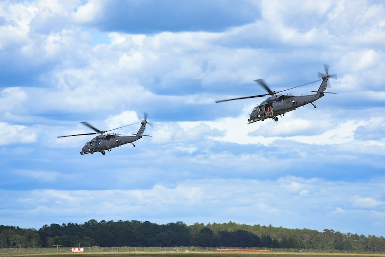 HH-60G Pavehawk helicopters launch in support of Tropical Storm Florence relief operations, Sept. 15, 2018, at Moody Air Force Base, Ga. The 334th Air Expeditionary Group launched HC-130J Combat King IIs, HH-60G Pavehawks, aircrew and support personnel to pre-position at Joint Base Charleston, S.C., for potential Tropical Storm Florence response. Under the command of Col. John Creel, the 374th Rescue Group commander, the AEG integrated to make one expeditionary search and rescue unit comprised of rescue and support personnel from both the 23d Wing, 920th Rescue Wing at Patrick Air Force Base, Fla., and 51st Combat Communications Squadron at Robins Air Force Base, Ga. (U.S. Air Force photo by Senior Airman Greg Nash)