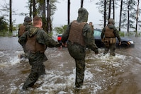 Marines with Marine Corps Base Camp Lejeune help push a car out of a flooded area during Hurricane Florence, on Marine Corps Base Camp Lejeune, Sept. 15, 2018. Hurricane Florence impacted MCB Camp Lejeune and Marine Corps Air Station New River with periods of strong winds, heavy rains, flooding of urban and low lying areas, flash floods and coastal storm surges.