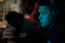 U.S. Navy Midshipman Suwen Jordan Sun helps read data for the Navy Airborne Expendable Bathythermographs deployed from the WC-130J Hercules during an Air Force Reserve Hurricane Hunter mission from the Air Dominance Center, Savannah, Ga., Sept. 12, 2018. The 53rd Weather Reconnaissance Squadron, or Hurricane Hunters, provides critical and timely weather data for the National Hurricane Center to assist in providing up-to-date and accurate information for storm forecasts. (U.S. Air Force photo by Tech. Sgt. Chris Hibben)