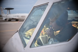Capt. Josh Archer, an E-3G Airborne Warning and Control System pilot, reads back his clearance during pre-flight operations in the early morning of Sept. 15, 2018 at Tinker Air Force Base, Oklahoma. Capt. Archer and his crew are from the 552nd Air Control Wing, 960th Airborne Air Control Squadron, based at Tinker AFB and are shown preparing for a mission supporting the response to Hurricane Florence Sept. 15, 2018, Tinker Air Force Base, Oklahoma. The AWACS will provide air control and de-confliction service along the East Coast of the United States as they monitor and control airspace as local, state and federal assets move in to the area to conduct rescue and recovery operations. (U.S. Air Force photo/Greg L. Davis)