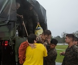 U.S. Marines assigned to Combat Logistics Group 8 aid in evacuating the local populace in Jacksonville, N.C., Sept. 15, 2018. CLB-8 provided direct logistical support in providing disaster relief to civilians affected by Hurricane Florence.