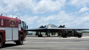 A U.S. Air Force B-2 Spirit, deployed from Whiteman Air Force Base, Missouri, connects to a fuels truck during a hot-pit refueling at Wake Island Airfield Sept. 14, 2018.