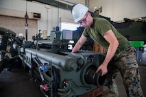 Cpl. Salvatore Ferrigno aligns a cannon tube during the reassembly of a M777 A2 Medium Towed Howitzer Sept. 14, 2018, at Camp Hansen, Okinawa, Japan. Armament Repair Platoon repairs weapons in support of 3rd Battalion, 12th Marine Regiment, 3rd Marine Division to ensure the safety of the Marines operating the weapons. Ferrigno is a machinist with Armament Repair Platoon, Ordnance Maintenance Company, 3rd Maintenance Battalion, Combat Logistics Regiment 35, 3rd Marine Logistics Group, and is a native of Barnegat, New Jersey. (U.S. Marine Corps photo by Pfc. Terry Wong)