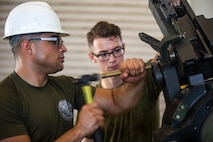 Lance Cpl. Dario Covarrubias hammers a part into place during the reassembly of a M777 A2 Medium Towed Howitzer Sept. 14, 2018, at Camp Hansen, Okinawa, Japan. Armament Repair Platoon repairs weapons in support of 3rd Battalion, 12th Marine Regiment, 3rd Marine Division to ensure the safety of the Marines operating the weapons. Covarrubias is an Amphibious Assault Vehicle mechanic with Armament Repair Platoon, Ordnance Maintenance Company, 3rd Maintenance Battalion, Combat Logistics Regiment 35, 3rd Marine Logistics Group, and is a native of Chicago, Illinois. (U.S. Marine Corps photo by Pfc. Terry Wong)