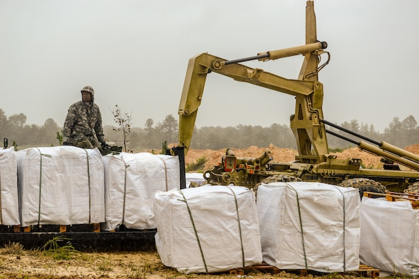 A Soldier with the South Carolina Army National Guard pauses for a moment while working with and the South Carolina Department of Transportation to fill sandbags as a result of flooding caused by Tropical Storm Florence, Sept. 15, 2018. Approximately 3,200 Soldiers and Airmen have been mobilized to prepare, respond and participate in recovery efforts as forecasters project Tropical Storm Florence has the potential to cause flooding and projected to damage the state as the storm makes landfall near the Carolinas and east coast.