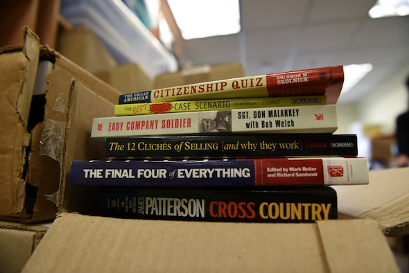 Library books donated by Kunsan's Rosenblum Memorial Library during a base wide Back to School Drive awaits packing at Kunsan Air Base, Republic of Korea, Sept. 13, 2018. The library donated more than 400 books and Airmen from across the base donated over 5,000 dollars in school supplies for local schools. (U.S. Air Force photo by Senior Airman Savannah L. Waters)
