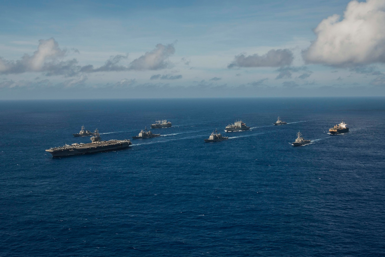 (Sept. 17, 2018) The aircraft carrier USS Ronald Reagan (CVN 76) leads the Ronald Reagan Strike group, including the Ticonderoga-class missile cruisers USS Antietam (CG 54) and USS Chancellorsville (CG 62) and the Arleigh Burke-class guided-missile destroyers USS Benfold (DDG 65) and USS Milius (DDG 69), during a photo exercise for Valiant Shield 2018.