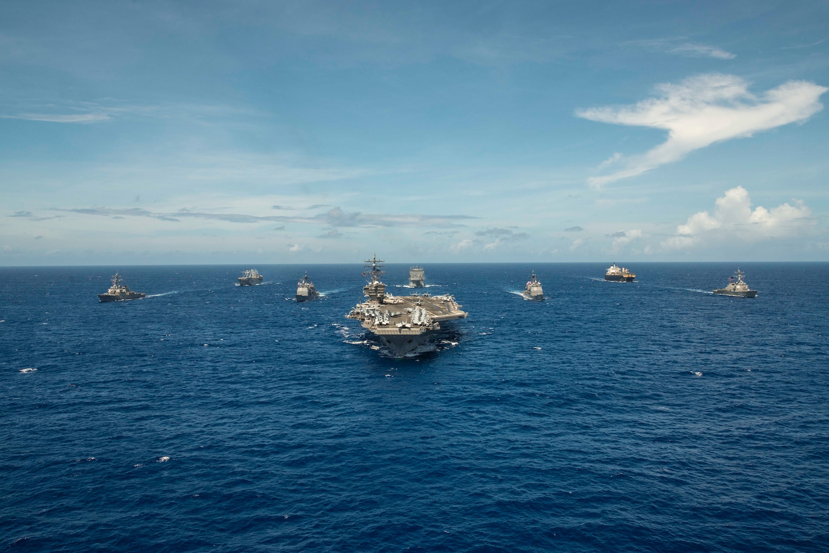 PHILIPPINE SEA (Sept. 17, 2018) The aircraft carrier USS Ronald Reagan (CVN 76) leads the Ronald Reagan Strike group, including the Ticonderoga-class missile cruisers USS Antietam (CG 54) and USS Chancellorsville (CG 62) and the Arleigh Burke-class guided-missile destroyers USS Benfold (DDG 65) and USS Milius (DDG 69), during exercise Valiant Shield 2018.