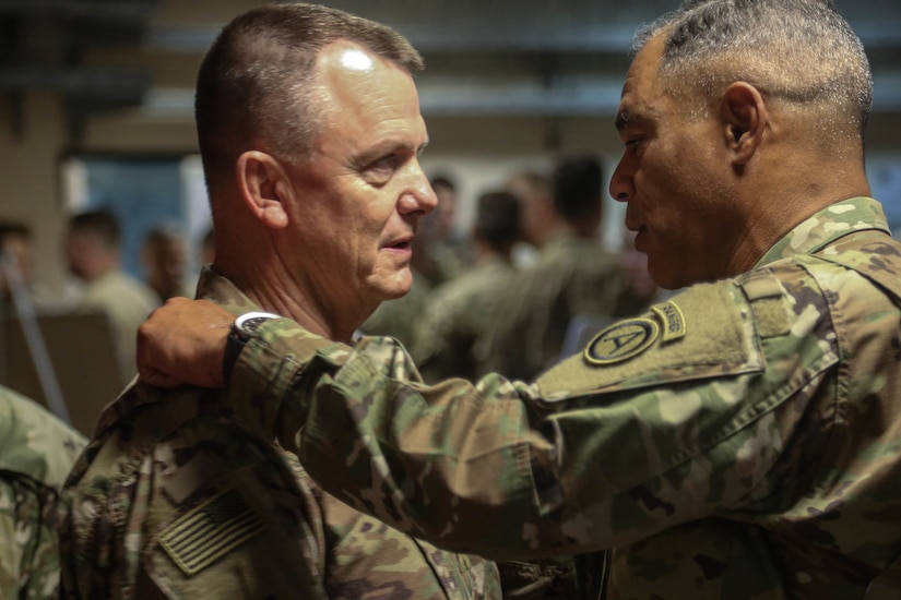 U.S. Army Lt. Gen. Michael X. Garrett, commanding general of U.S. Army Central, congratulates Lt. Gen. Paul E. Funk II, outgoing commanding general, Combined Task Force – Operation Inherent Resolve in Baghdad, Sept. 13, 2018.  The U.S. Army's III Armored Corps, deployed from Fort Hood, Texas, to areas in Southwest Asia, transferred its command authority to the XVIII Airborne Corps, deployed from Fort Bragg, North Carolina.  CJTF-OIR is a 79-member Global coalition, which works by, with, and through partner forces to defeat ISIS in designated areas of Iraq and Syria, and sets conditions for follow-on operations to increase regional stability.