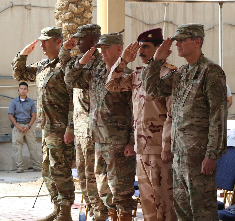 Distinguished visitors render courtesies during the Combined Joint Task Force – Operation Inherent Resolve transfer of authority ceremony in Baghdad,  Sept. 13, 2018.  The U.S. Army's III Armored Corps, deployed from Fort Hood, Texas, to areas in Southwest Asia, transferred its command authority to the XVIII Airborne Corps, deployed from Fort Bragg, North Carolina.  CJTF-OIR is a 79-member global coalition, which works by, with, and through partner forces to defeat ISIS in designated areas of Iraq and Syria, and sets conditions for follow-on operations to increase regional stability.
