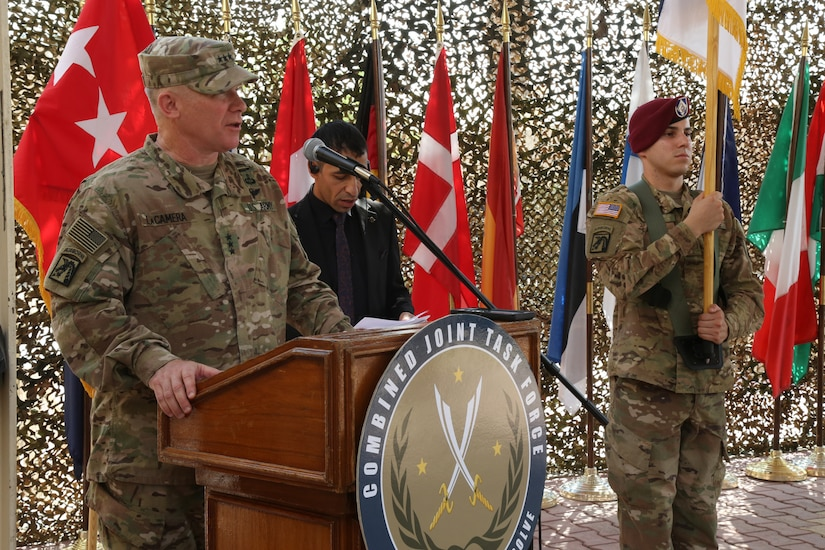 U.S. Army Lt. Gen. Paul LaCamera, commanding general of XVIII Airborne Corps and Combined Joint Task Force – Operation Inherent Resolve, speaks to attendees during a transfer of authority ceremony in Baghdad, Sept. 13, 2018. The U.S. Army's III Armored Corps, deployed from Fort Hood, Texas, to areas in Southwest Asia, transferred its command authority to the XVIII Airborne Corps, deployed from Fort Bragg, North Carolina.  CJTF-OIR is a 79-member global coalition, which works by, with, and through partner forces to defeat ISIS in designated areas of Iraq and Syria, and sets conditions for follow-on operations to increase regional stability.