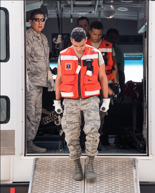 U.S. Airmen from the 60th Medical Group, Travis Air Force Base, California, transport a simulated patient during Exercise Ultimate Caduceus 2018 at Mather Airport, Sacramento, California, Aug. 23, 2018. Ultimate Caduceus 2018 is an annual patient movement exercise designed to test the ability of U.S. Transportation Command to provide medical evacuation. (U.S. Air Force photo by Louis Briscese)