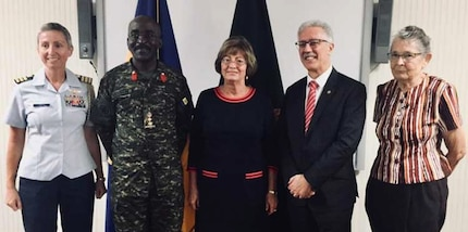 U.S. and Caribbean officials pose for a photo.