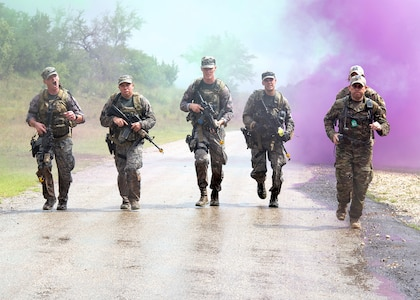 Airmen from the Air National Guard Air Force Defender's Challenge Team 2018 run to the finish line of the dismounted operations portion of the competition at Joint Base San Antonio-Camp Bullis, Texas, Sept. 12.