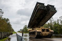 Marines from Mobility Assault Company, 2nd Combat Engineer Battalion, 2nd Marine Division, deploy a armored vehicle launch bridge after Hurricane Florence on Marine Corps Base Camp Lejeune, Sept. 16, 2018. Hurricane Florence impacted MCB Camp Lejeune and Marine Corps Air Station New River with periods of strong winds, heavy rains, flooding of urban and low lying areas, flash floods and coastal storm surges.