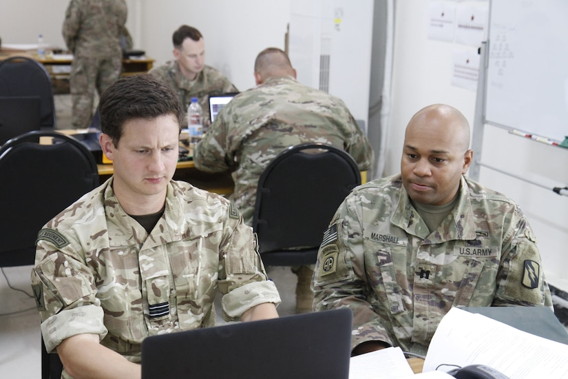 Soldiers from both the United States and United Kingdom armed forces participate in the command post exercise on September 10, 2018. The command post exercise was designed to strengthen strategic relationships between multinational armed forces to solve potential real life threats.