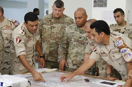 Soldiers from both the United States and Egyptian armed forces review battle plans during the command post exercise September 10, 2018. The command post exercise was designed to strengthen strategic relationships between multinational armed forces to solve potential real life threats.