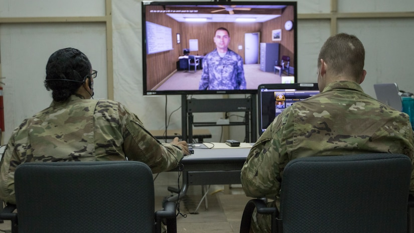 U.S. Army Master Sgt. Breyda Pereyra, left, the noncommissioned officer in charge of U.S. Army Central's G37 office, and U.S. Army Capt. Jordan Smith, the outgoing officer in charge of the U.S. Army Central Readiness Training Center, speak with a virtual Soldier avatar in an Intelligence and Electronic Warfare Tactical Proficiency Trainer program designed to simulate a conversation with a Soldier having suicidal thoughts, Camp Buehring, Kuwait, Sept. 12, 2018. Suicide prevention is an enduring goal of the U.S. Army to ensure the safety and well-being of all Soldiers, Department of the Army civilians, and contractors.