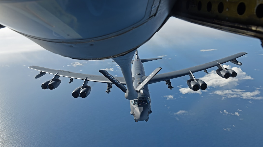 U.S. Air Force B-52 Stratofortress receives fuel from a U.S. Air Force KC-135 Stratotanker during an air-refueling mission off the coast of Norway, Sept. 15, 2018. The purpose of the flight was to conduct theater familiarization for aircrew members and to demonstrate U.S. commitment to allies and partners through the global employment of our military forces. (U.S. Air Force photo by Senior Airman Luke Milano)