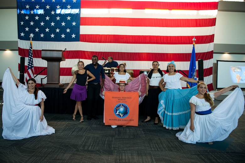 Performers pose for a photo during the 23d Wing Diversity Day, Sept. 14, 2018, at Moody Air Force Base, Ga. Diversity Day honored the cultures of all groups and organizations observed by the Department of Defense using forms of expression such as poems and native dances. The theme of this year was 'Many Cultures, One Voice: Stronger Through Inclusion And Equality'. (U.S. Air Force photo by Airman 1st Class Erick Requadt)