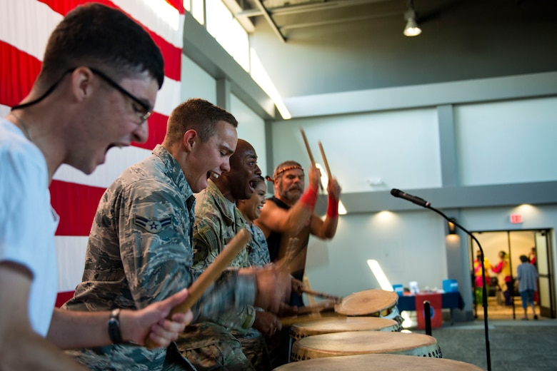 Team Moody Airmen participate in a drumming demonstration with the Tampa Taiko drummers during the 23d Wing Diversity Day, Sept. 14, 2018, at Moody Air Force Base, Ga. Diversity Day honored the cultures of all groups and organizations observed by the Department of Defense using forms of expression such as poems and native dances. The theme of this year was 'Many Cultures, One Voice: Stronger Through Inclusion And Equality'. (U.S. Air Force photo by Airman 1st Class Erick Requadt)