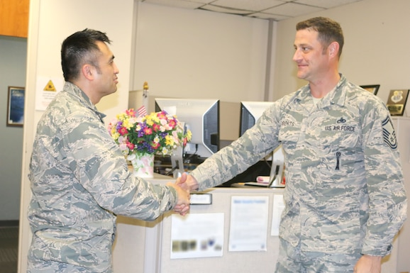 Col. John Tran (left), AEDC Test Systems Sustainment Chief, speaks to Senior Master Sgt. Michael Roberts in the TSS Office at Arnold AFB. (U.S. Air Force photo by Deidre Ortiz) (This image was manipulated by obscuring items for security purposes)