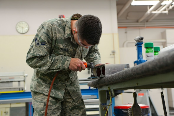 U.S. Air Force Airmen from the 168th Aircraft Maintenance Squadron, assesses damage on an aircraft part Sept. 7, 2018, on Eielson Air Force Base, Alaska. Aircraft structural mechanics modify and alter aircraft parts according to the desired engineering specifications.(U.S. Air Force photo by Airman Aaron Guerrisky)