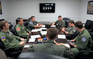 Instructor pilots assigned to the 37th Flying Training Squadron prepare for an upcoming flyover Sept. 4, 2018, on Columbus Air Force Base, Mississippi. Four T-6 Texan IIs flew over the Notre Dame Stadium before the kickoff of the Notre Dame versus Ball State football game in South Bend, Indiana, Sept. 8. (U.S. Air Force photo by Senior Airman Vincent Espinoza)