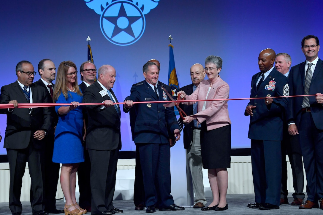 Secretary of the Air Force Heather Wilson, Air Force Chief of Staff Gen. David L. Goldfein, Chief Master Sgt. of the Air Force Kaleth O. Wright and Air Force Association leadership cut a ribbon during the 2018 AFA Air, Space and Cyber Conference in National Harbor, Md., Sept. 17, 2018. Cutting the ribbon symbolized the opening of the conference's exhibition hall. (U.S. Air Force photo by Wayne Clark)