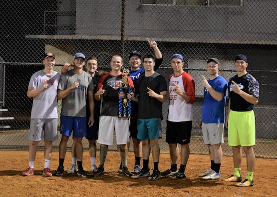The 50th Flying Training Squadron softball team stands with the trophy Sept. 11, 2017, on Columbus Air Force Base, Mississippi, after beating the 14th Medical Group in the Intramural Softball Championship. The 50th Flying Training Squadron won the second of two games and the championship with a score of 12-1 against the 14th Medical Group. (U.S. Air Force photo by Airman Hannah Bean)