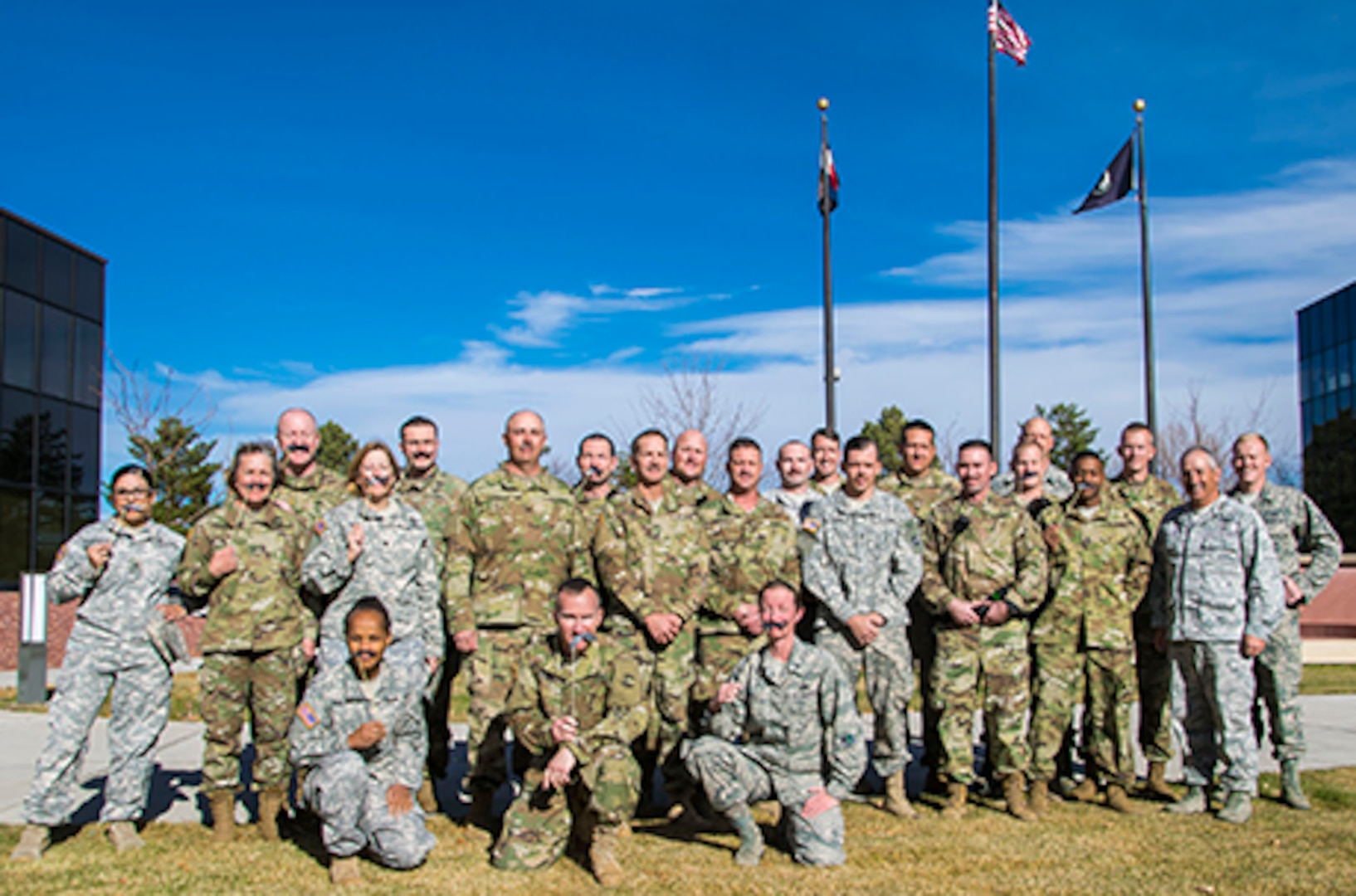 Service members from Joint Force Headquarters - Colorado joined the Adjutant General, Maj. Gen. H. Michael Edwards, for a MOvember group photo, to honor the occasion.