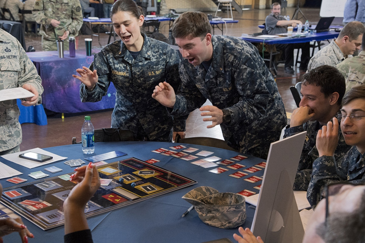 US Navy NCX participants work together around a table