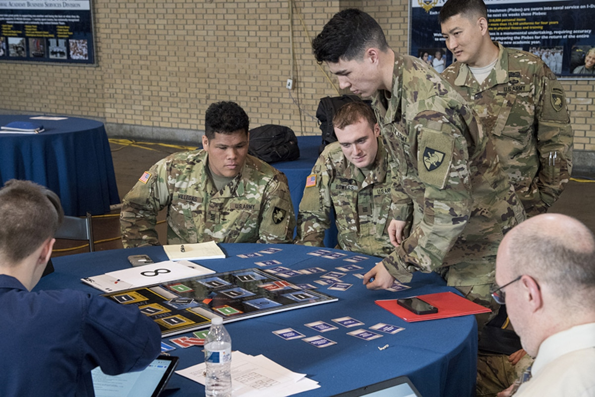 US Army NCX participants work together around a table