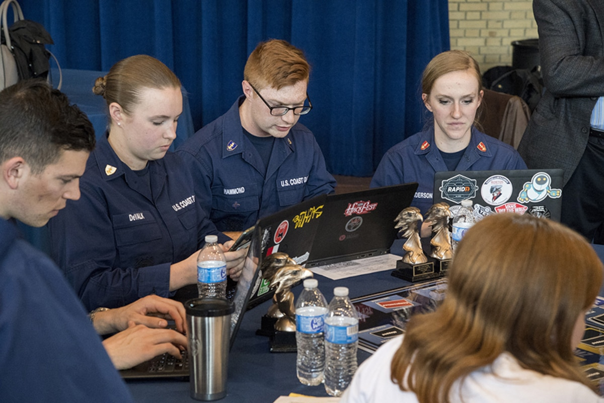 US Coast Guard NCX participants work at computers