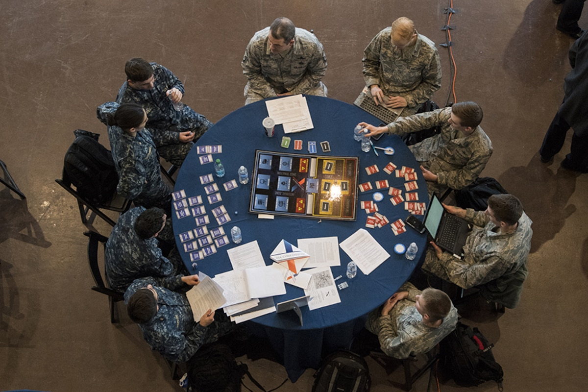 Overhead photo of NCX participants working around a table