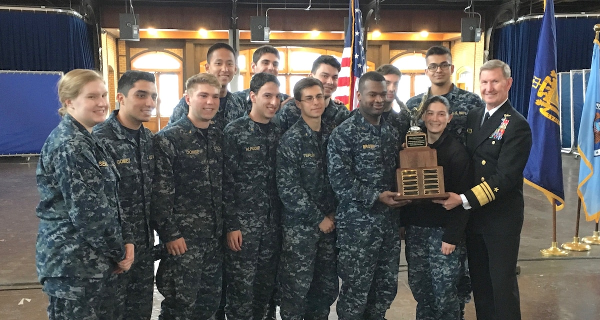 NCX winners from the US Naval Academy pose with their trophy